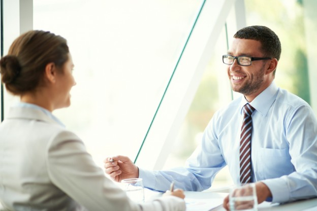 Businessman and businesswoman talking during face-to-face meeting