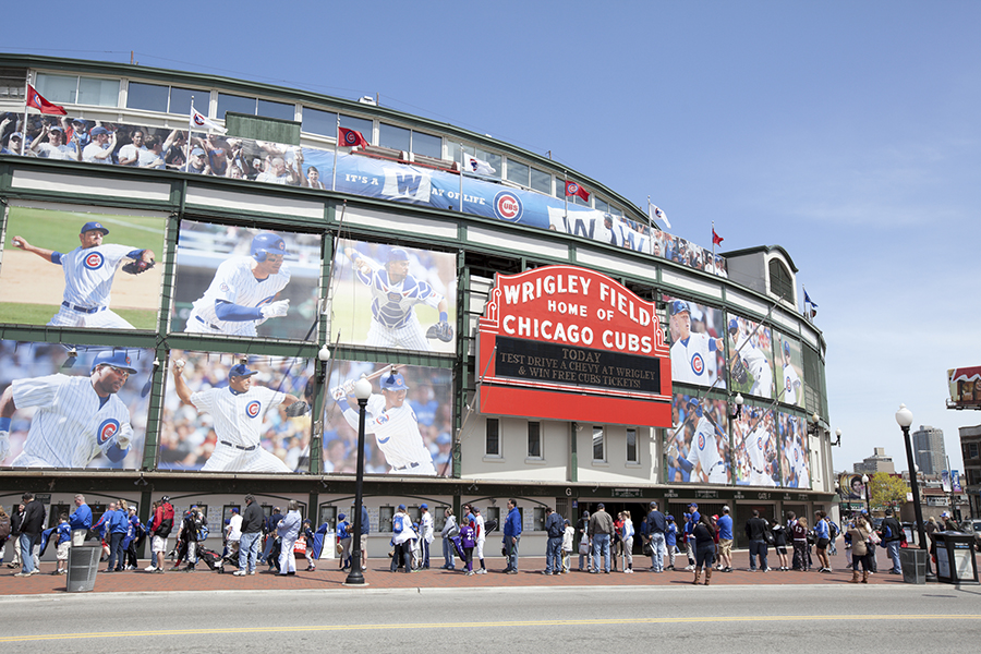 Chicago, USA- May 1,2011: Wrigley Field Stadium - Home of Chicago Cubs - major league baseball team of Chicago and people waiting in line in front of it. Wrigley Field is one of the oldest baseball fields in the country.