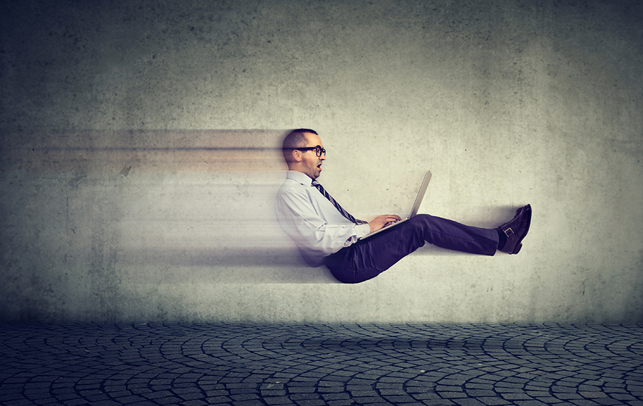 Fast internet concept. Levitating business man on road using laptop computer